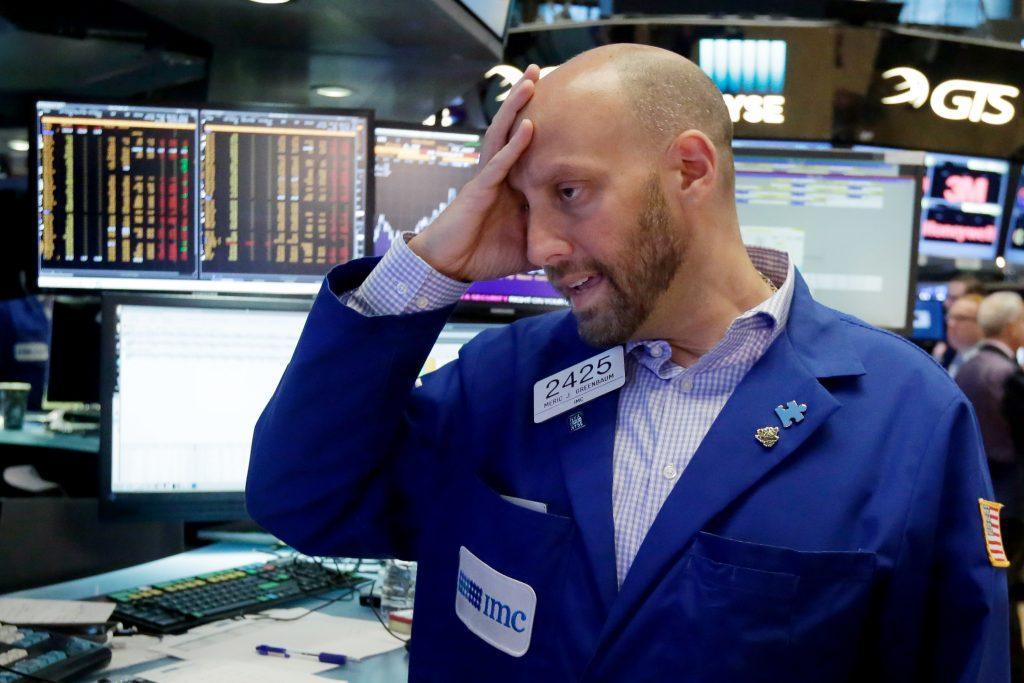 Specialist Meric Greenbaum on the floor of the New York Stock Exchange on Friday. (AP Photo/Richard Drew)