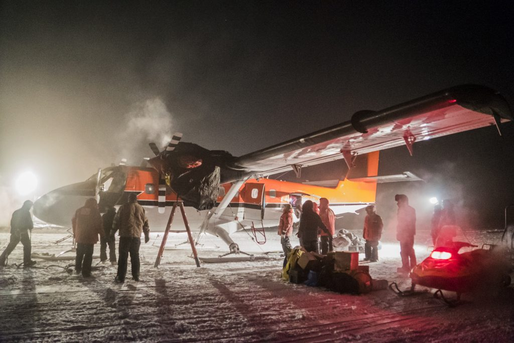 A plane picks up a sick worker at the U.S. South Pole science station. (Robert Schwarz/NSF via AP)