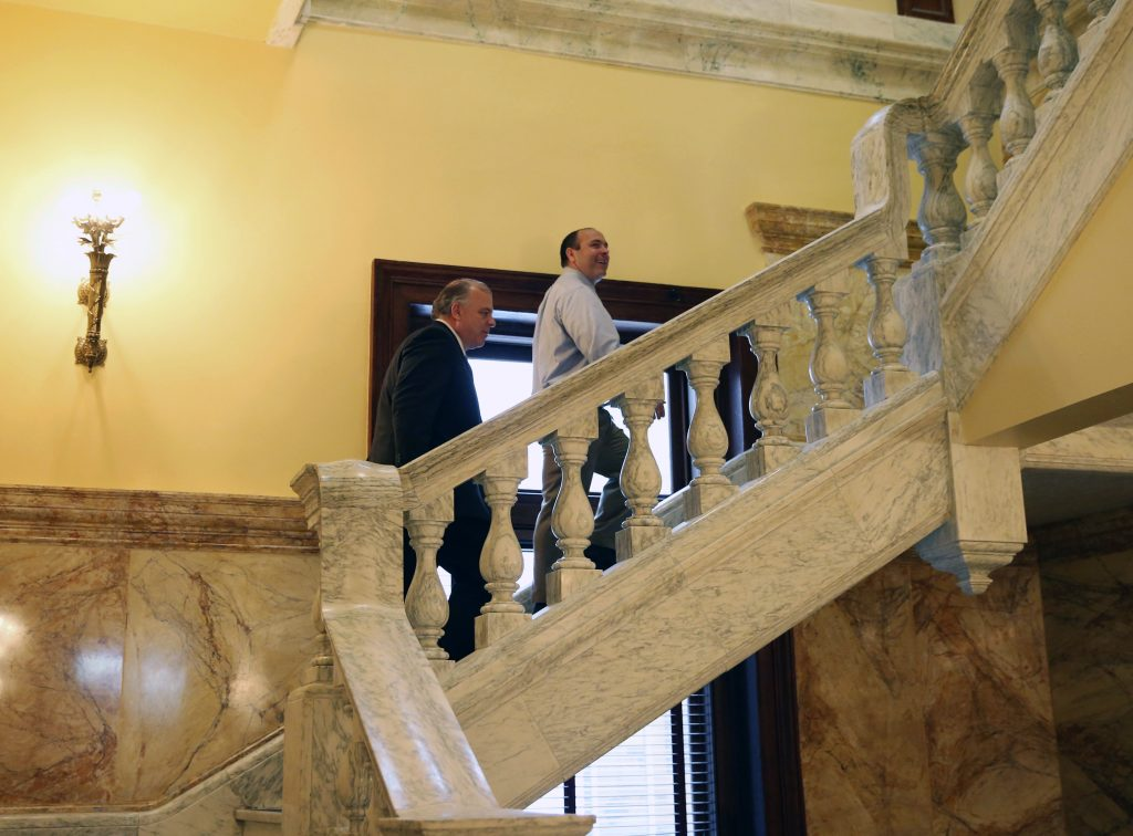 New Jersey Senate President Steve Sweeney, left, D-West Deptford, N.J., and New Jersey Assembly Speaker Vincent Prieto, D- Secaucus, N.J., walks in the Statehouse in Trenton. (AP Photo/Mel Evans)
