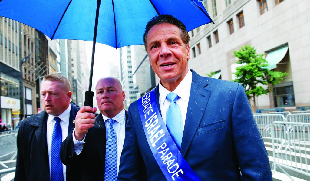 New York Gov. Andrew Cuomo marching in the annual Celebrate Israel parade, June 5, 2016, in New York. (AP Photo/Kathy Willens)