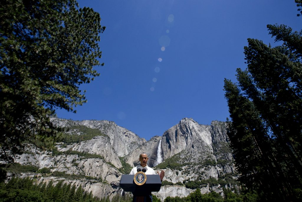 President Barack Obama speaks by the Sentinel Bridge in the Yosemite Valley, in front of Yosemite Falls which is the highest waterfall in the park at Yosemite National Park, Calif. (AP Photo/Jacquelyn Martin)
