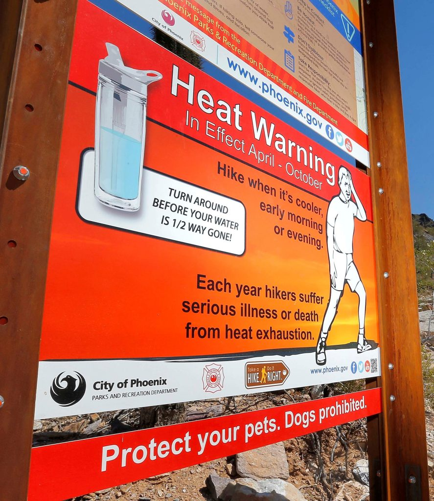 Signs warning of extreme heat on a trailhead in Piestewa Peak in Phoenix on Wednesday. (AP Photo/Matt York)