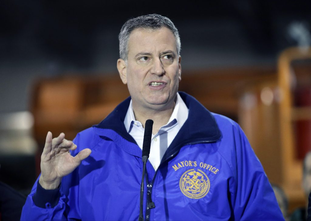 New York City Mayor Bill de Blasio speaks during a news conference in the Queens in 2014. (AP Photo/Frank Franklin II, File)