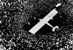 An enormous crowd at Le Bourget Airfield, near Paris, surrounds the Spirit of St. Louis after Charles A. Lindbergh completed the first nonstop transatlantic flight, on Saturday, May 21, 1927.  Lindbergh left Roosevelt Field in New York at 7:52 a.m. on May 20 and landed at Le Bourget at 5:24 p.m., Paris time, after a flight of 33 hours 32 minutes.  (AP Photo)
