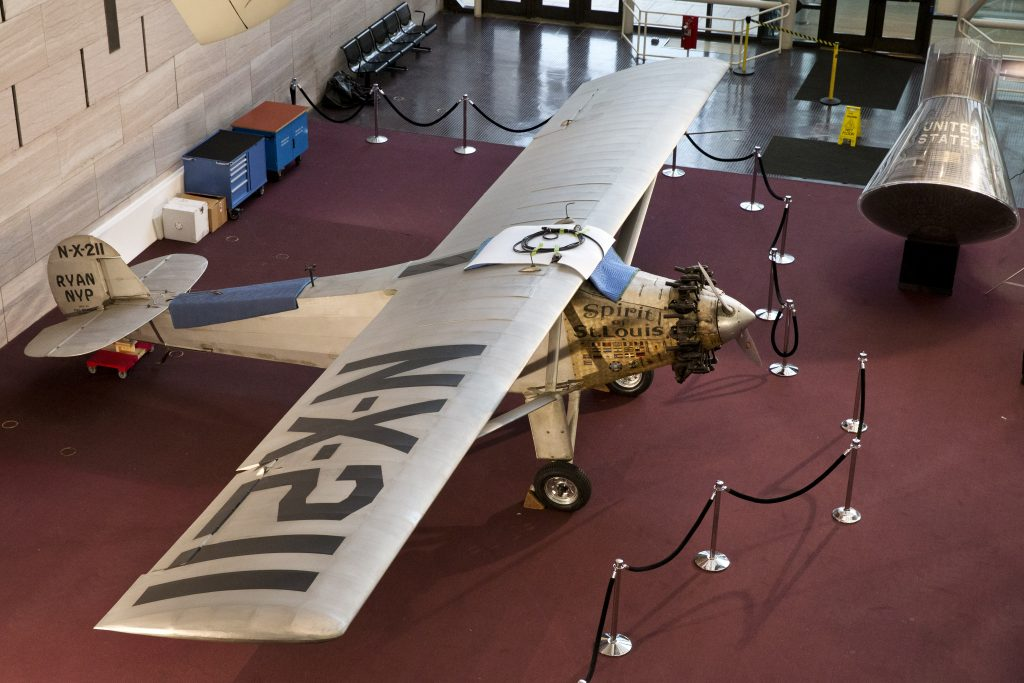 The Spirit of St. Louis is seen on the ground floor of the  National Air and Space Museum on Jan. 15, 2015, after being lowered for the first time in more than 20 years to have conservation work done and giving visitors a rare chance to see it up close in Washington. (AP Photo/Jacquelyn Martin)
