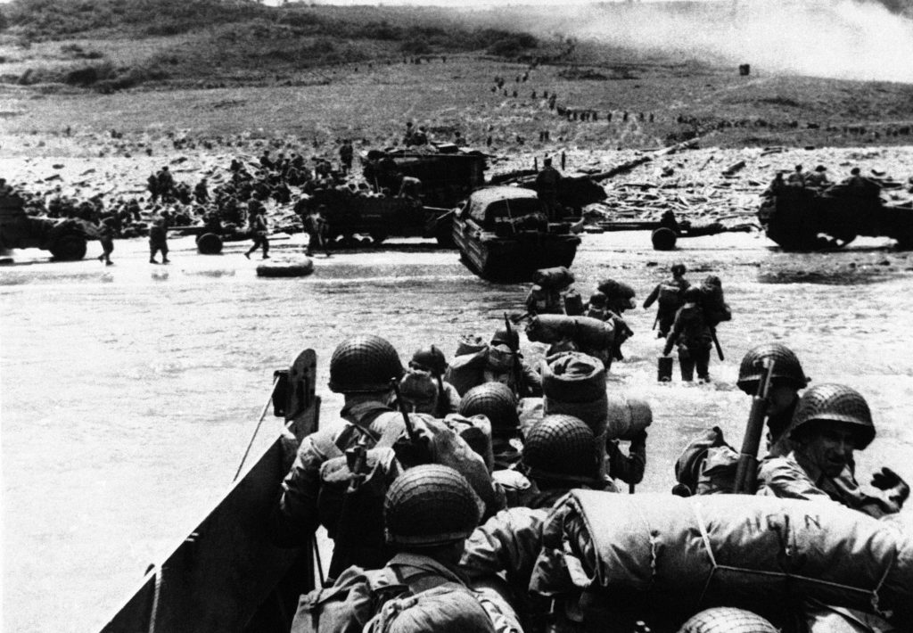 Troops and vehicles head ashore during the invasion of France by the Allied force along the Normandy coast on June 6, 1944. (AP Photo)
