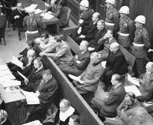 A view of the defendants' box at the Nuremberg trials on Nov. 22, 1945. From left to right are, yemach shemam, Herman Goering restsing his face on his arms;  Rudolf Hess; Joachim von Ribbentrop; Fritz Sauckel; Baldur von Schirach.  (AP Photo)