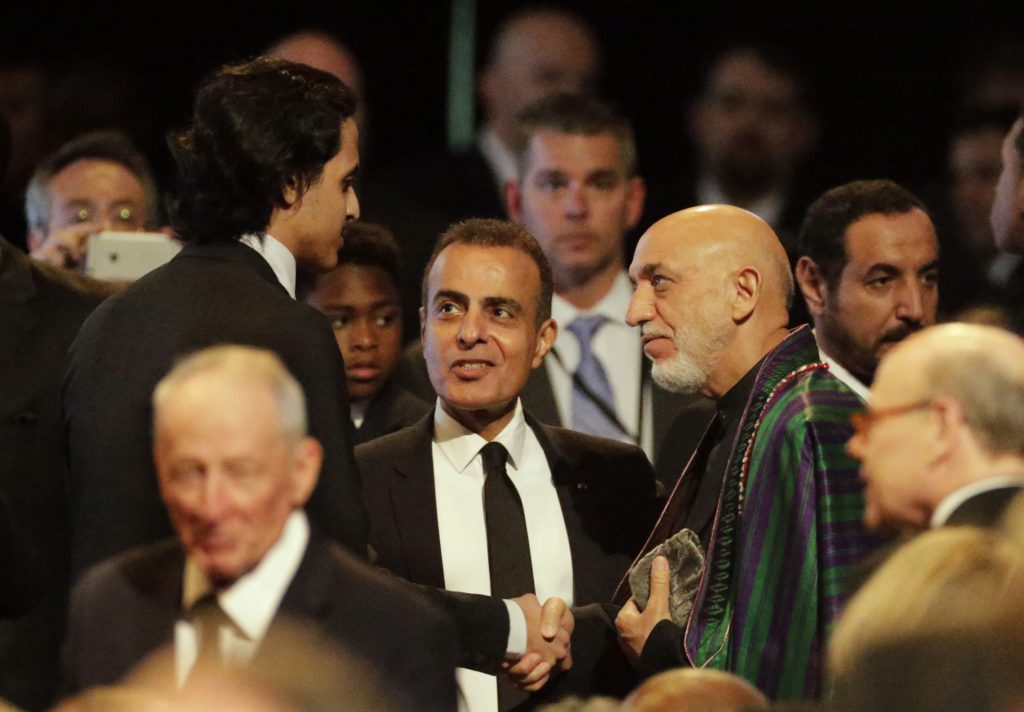 Former President of Afghanistan Hamid Karzai (in green robe) in Louisville, Ky., last week. (AP Photo/David Goldman)