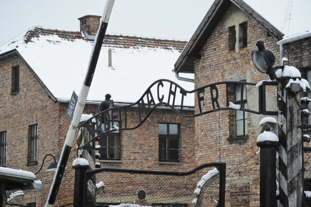 """The """"Arbeit Macht Frei"""" (Work Sets You Free) sign above the entrance gate of the Auschwitz Nazi death camp. (AP Photo/Alik Keplicz)"""