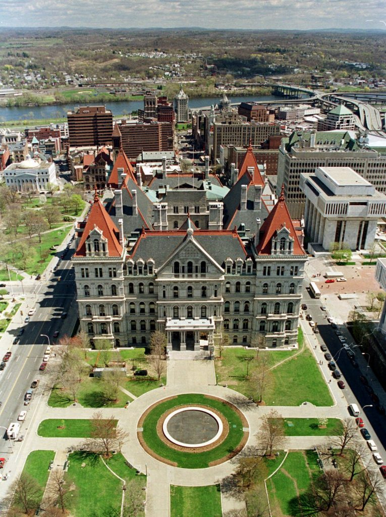 The New York State Capitol building in downtown Albany, N.Y., is shown with the Hudson River in the background on April 28, 1999. The Capitol, unique in that it has a number of peaked red roofs instead of a dome, was Completed in 1897. (AP Photo/Jim McKnight)