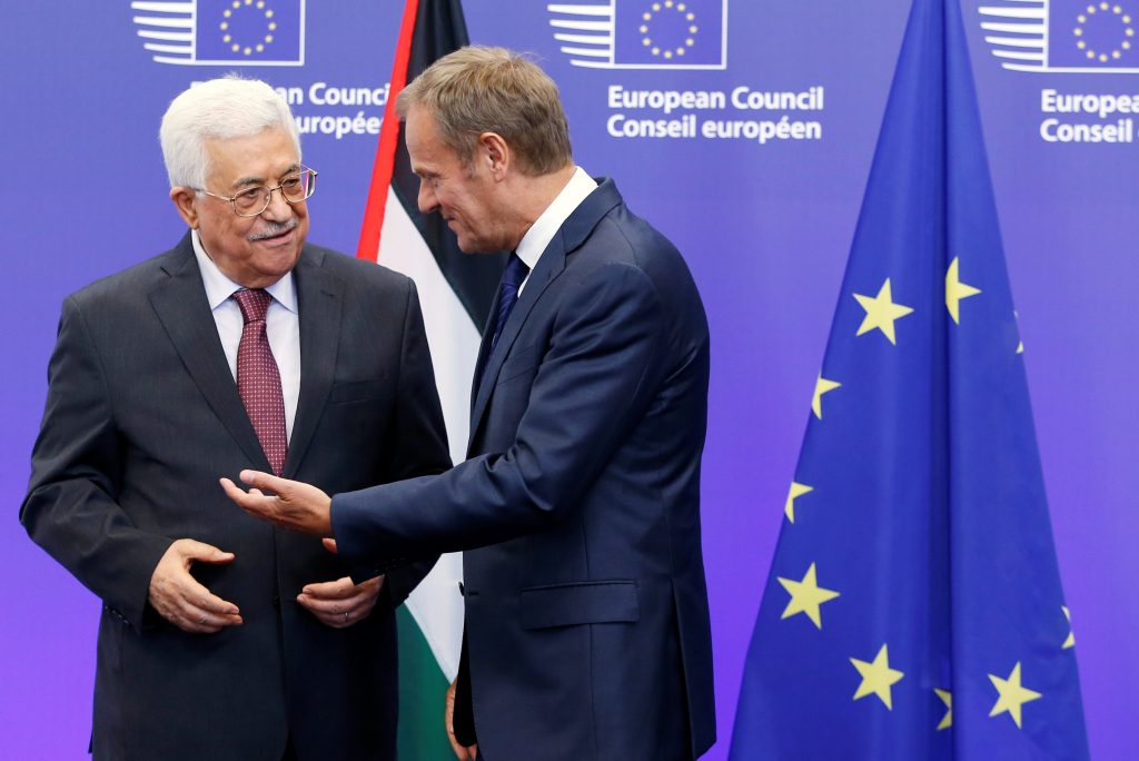 European Council President Donald Tusk welcomes Palestinian President Mahmoud Abbas (L) ahead of a meeting in Brussels, Belgium, on Thursday. (Reuters/Francois Lenoir)