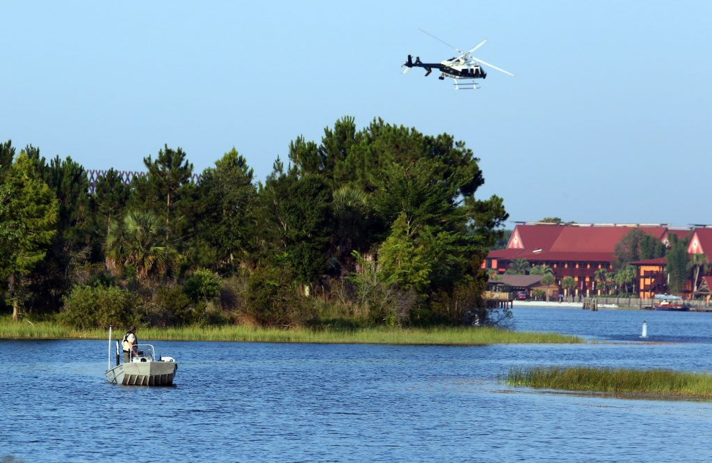 Florida Fish and Wildlife and an Orange County Sheriffs helicopter search for the missing toddler early Wednesday. (Red Huber/Orlando Sentinel via AP)
