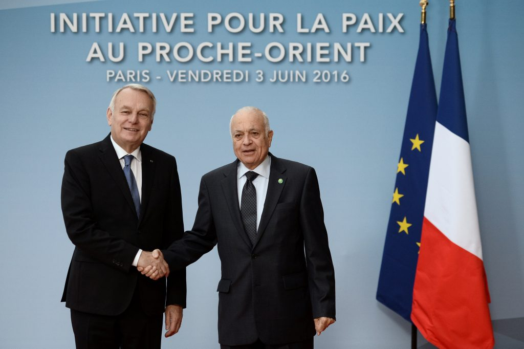 French Foreign Minister Jean Marc Ayrault (L) shakes hands with Arab League secretary-general Nabil al-Aarabi at the French-led bid to hold talks regarding peace between Israel and the Palestinians, in Paris, Friday. (Stephane de Sakutin/Pool/Reuters)
