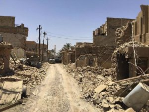 Iraqi security forces enter the al-Julan neighborhood in Fallujah on Sunday. (AP Photo)
