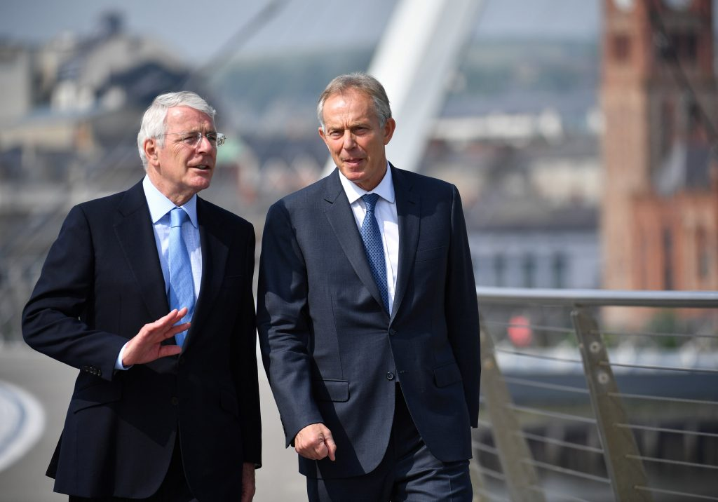 Former British prime ministers John Major (L) and Tony Blair speak as they walk across the Peace Bridge, before a news conference on the EU referendum, in Londonderry, Northern Ireland June 9, 2016. REUTERS/Jeff J Mitchell/Pool