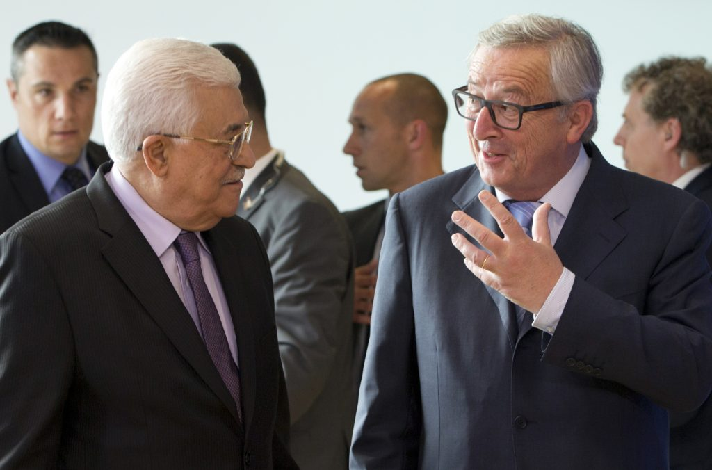 Palestinian President Mahmoud Abbas, second left, speaks with European Commission President Jean-Claude Juncker, second right, prior to a meeting at EU headquarters in Brussels on Wednesday, June 22, 2016. Abbas is on a two-day trip to Brussels to meet with EU leaders. (AP Photo/Virginia Mayo)