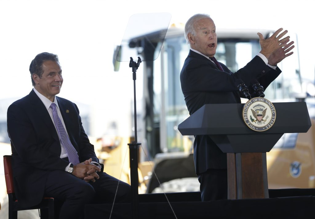 Vice President Joe Biden (R) speaks during a news conference at LaGuardia Airport in New York on Tuesday, as New York Governor Andrew Cuomo looks on. (AP Photo/Seth Wenig)