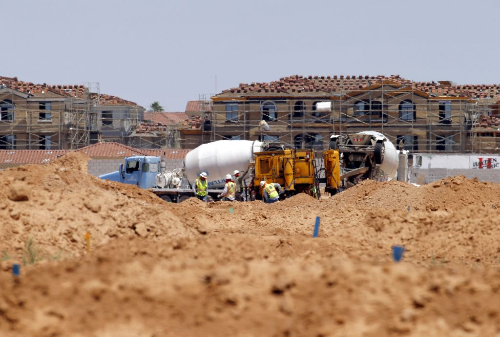 Crews preparing a site for new homes in Chandler, Ariz., last month. (AP Photo/Matt York)