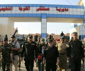 Iraqi Prime Minister Haider al-Abadi walks with Iraqi officers during his visit the city of Fallujah on Sunday. (Iraqi Prime Minister's Office/Handout via Reuters)