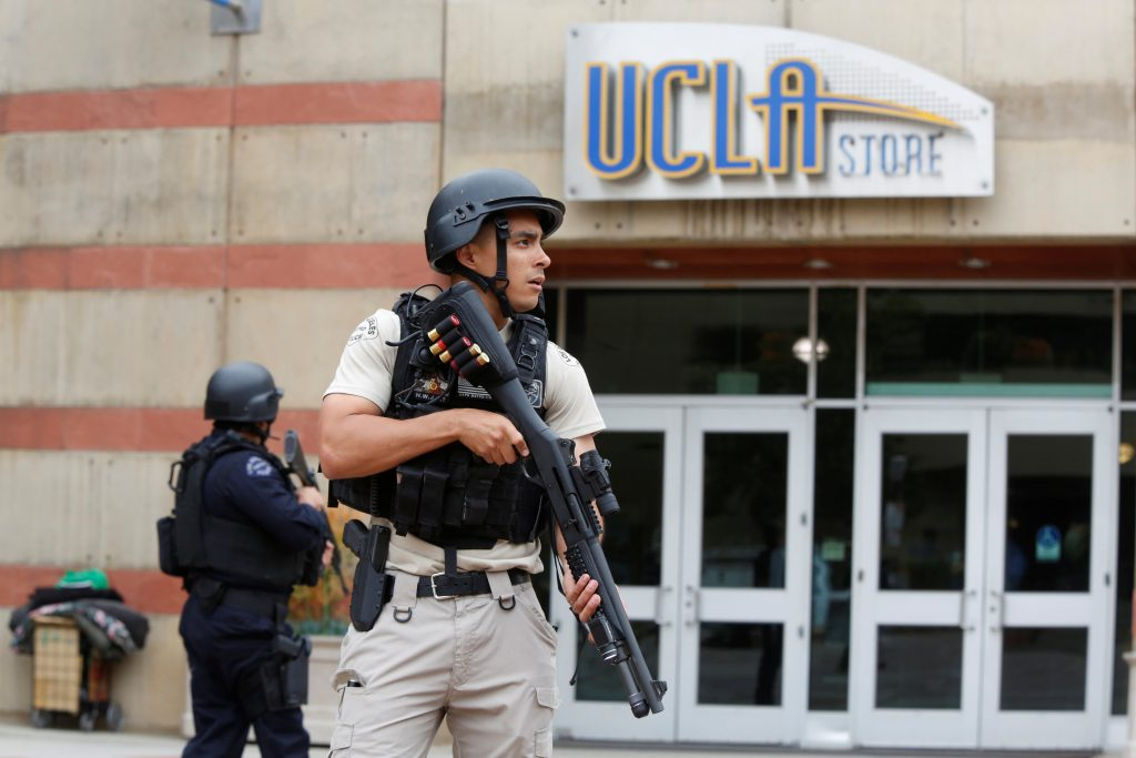 A Los Angeles Metro Police officer stands watch on the University of California, Los Angeles (UCLA) campus after it was placed on lockdown following reports of a shooter in Los Angeles, California June 1, 2016. REUTERS/Patrick T. Fallon TPX IMAGES OF THE DAY