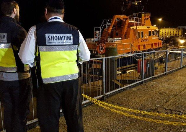 Shomrim volunteers waiting by the lifeboat in Dover. (Shomrim)