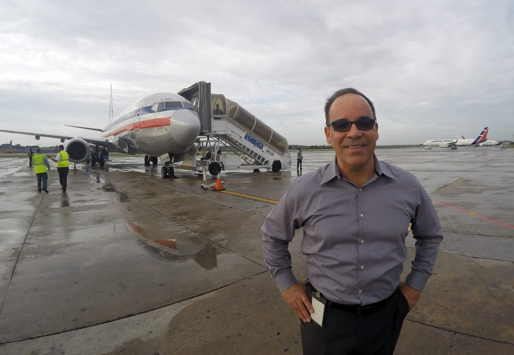 Galo Beltran, Cuba country manager for American Airlines, poses for a picture near a charter flight operated by American at Havana's Jose Marti International Airport. (AP Photo/Scott Mayerowitz)