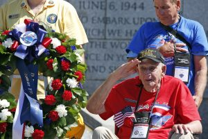 "Hank Tussy, from Rio Vista, Calif., a veteran of D-Day, salutes during the playing of ""Taps,"" during a ceremony on Monday at the World War II Memorial in Washington. (AP Photo/Alex Brandon)"