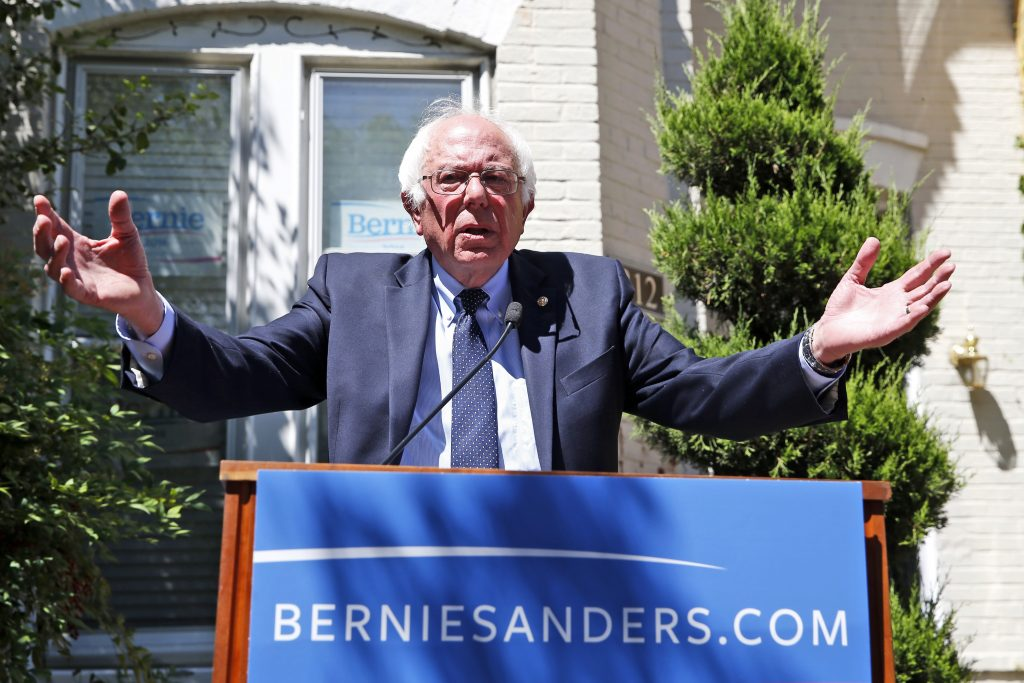 In this June 14, 2016, photo, Democratic presidential candidate, Sen. Bernie Sanders, I-Vt., speaks during a news conference outside his campaign headquarters in Washington. For Hillary Clinton and Sanders, getting to that Unity, New Hampshire, moment might take some time. (AP Photo/Alex Brandon)