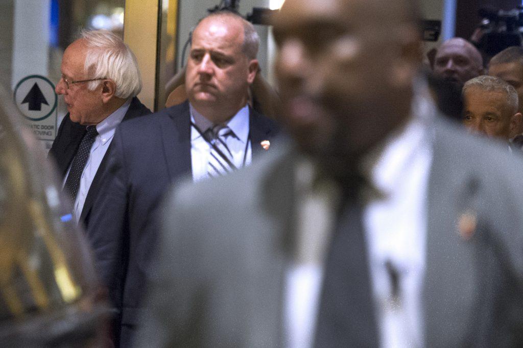 Democratic presidentiail candidate Sen. Bernie Sanders, I-Vt., left, leaves the Capitol Hilton after meeting with Democratic presidential candidate Hillary Clinton in Washington, Tuesday, June 14, 2016. (AP Photo/Cliff Owen)