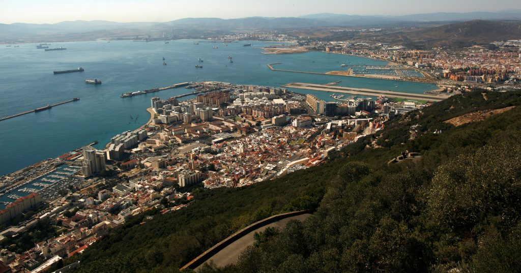 A general view of the British overseas territory of Gibraltar (bottom), the Spanish city of La Linea de la Concepcion (R) and Algeciras Bay are pictured from the Rock, a monolithic limestone promontory, in Gibraltar, south of Spain August 16, 2013. REUTERS/Jon Nazca/File Photo