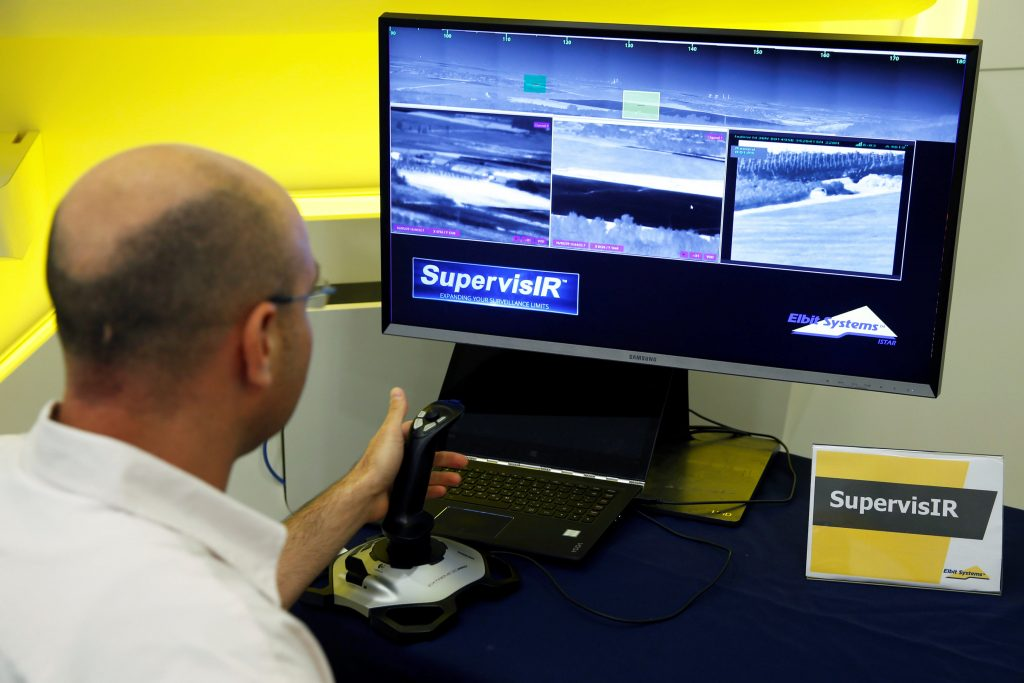 An employee demonstrates the SupervisIR, a ground-based infrared surveillance system, during a preview presentation at Elbit Systems in Netanya, Israel, on Wednesday.(Reuters/Baz Ratner)