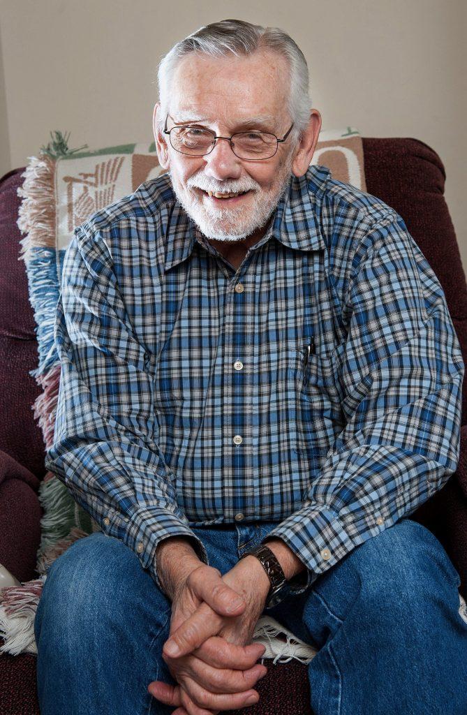 Herman Schneider poses at his home in Rantoul, Ill. (Rick Danzl/The News-Gazette via AP)
