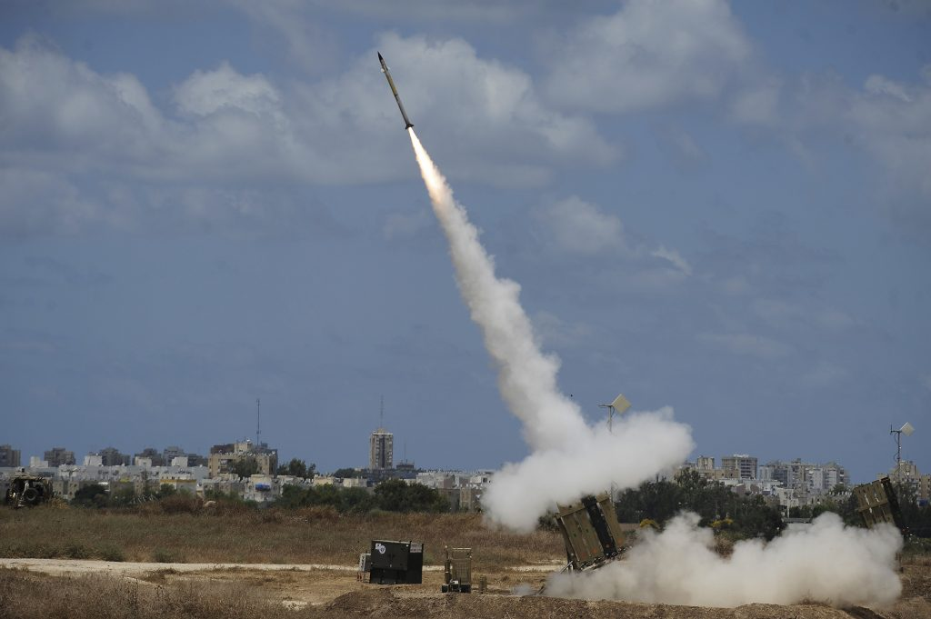 FILE - An Iron Dome Missile Defense battery set up near the Southern town of Ashdod fires an intercepting missile on July 14, 2014. (David Buimovitch/Flash90/FILE)
