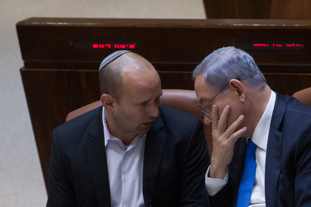 Israeli Prime Minister Benjamin Netanyahu (R) seen with Minister of Education Naftali Bennett during a plenum session in the assembly hall of the Israeli parliament on June 17, 2015. Photo by Miriam Alster/FLASH90