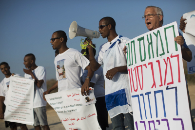 Demonstrators hold placards during a protest calling for the release of Avraham Mengistu. Photo by Yonatan Sindel/Flash90