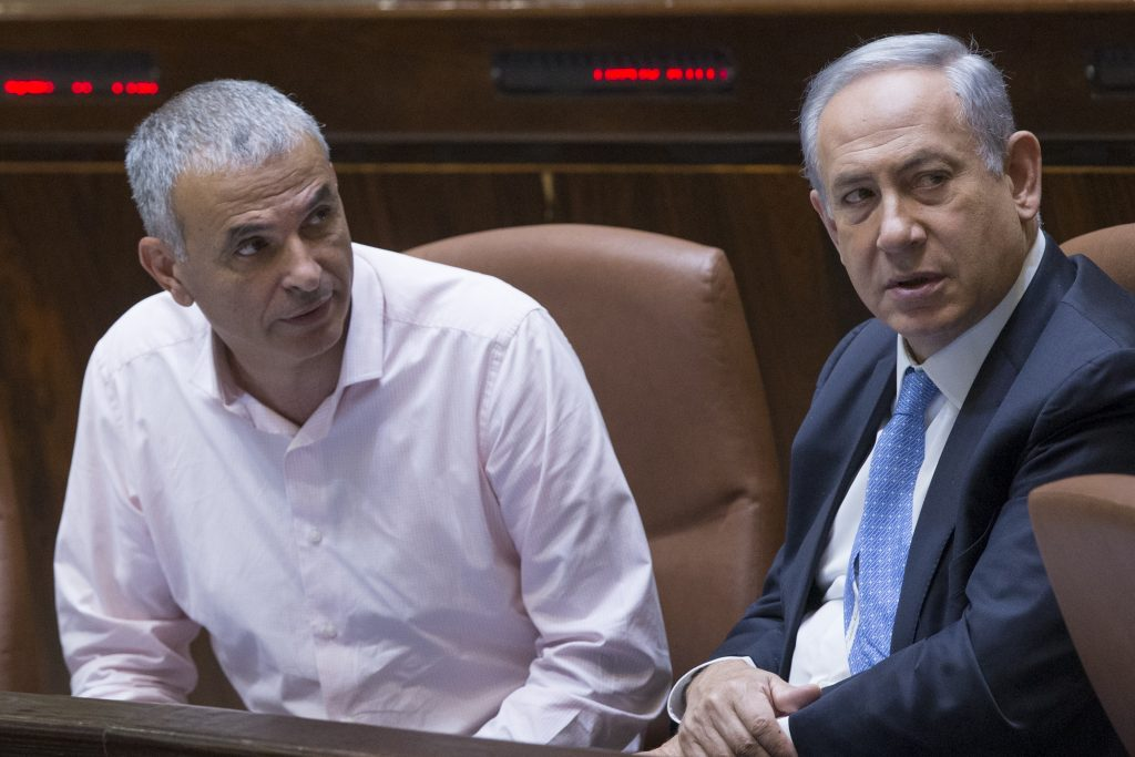 Finance Minister Moshe Kahlon (L) speaks with Prime Minister Binyamin Netanyahu at the Knesset last week. (Yonatan Sindel/Flash90)