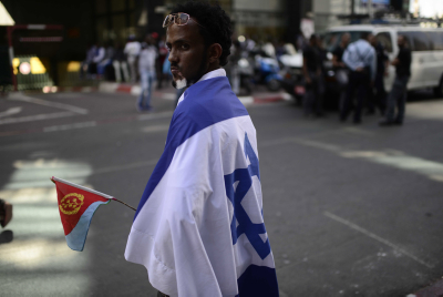 Eritrean migrants protest in front of the European Union embassy, calling for the EU to try the Eritrean leadership for crimes against humanity, on June 21, 2016. Photo by Tomer Neuberg/Flash90