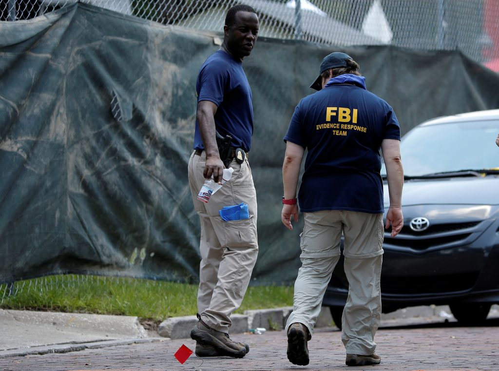FBI investigators work at the crime scene of a mass shooting at the Pulse gay night club in Orlando, Florida, June 13, 2016. REUTERS/Jim Young
