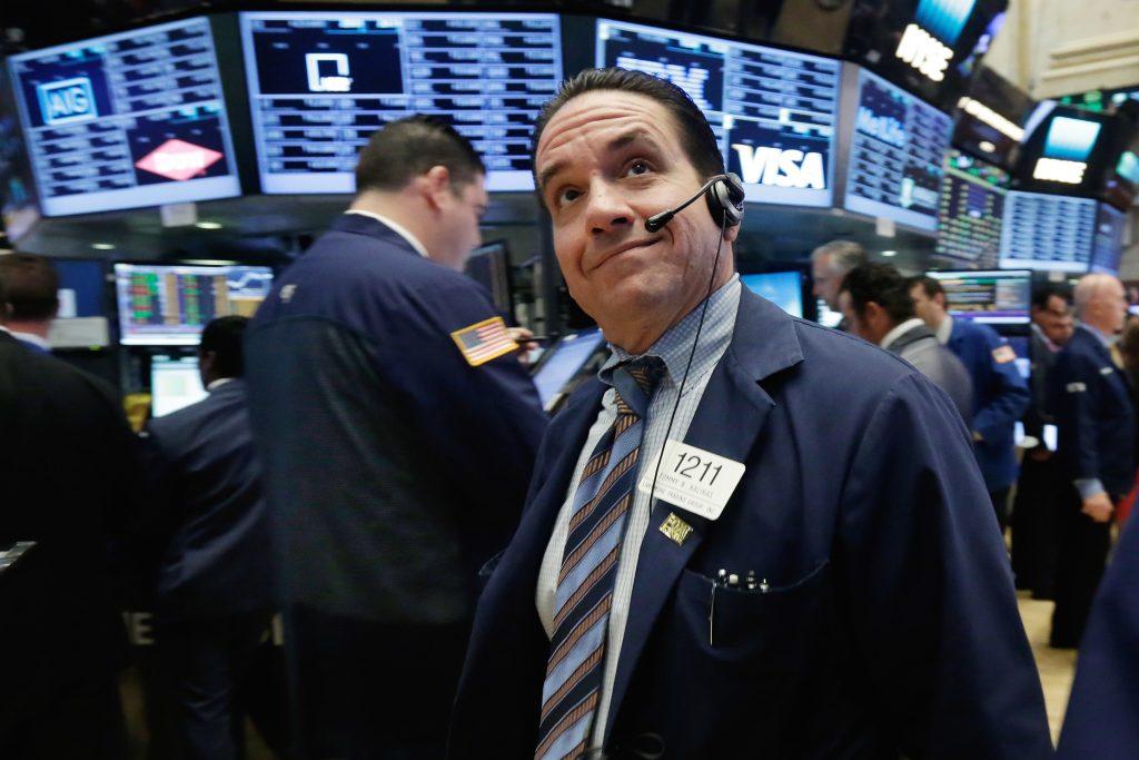 Trader Tommy Kalikas works on the floor of the New York Stock Exchange on Monday. (AP Photo/Richard Drew)