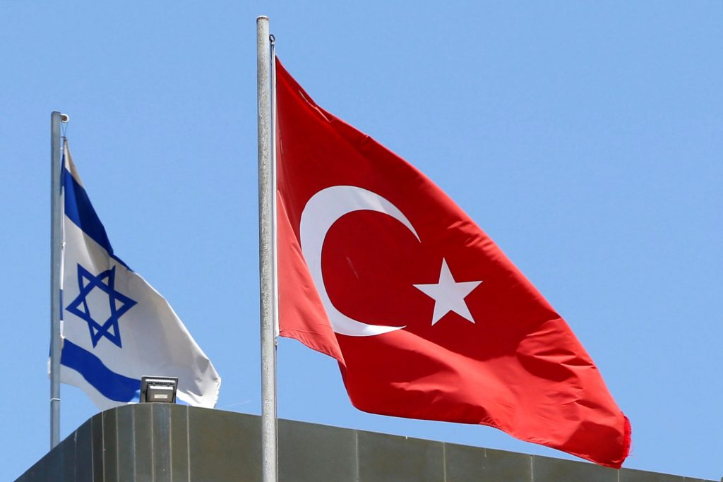 A Turkish flag flutters atop the Turkish embassy as an Israeli flag is seen nearby, in Tel Aviv, Israel June 26, 2016. Picture taken June 26, 2016. REUTERS/Baz Ratner