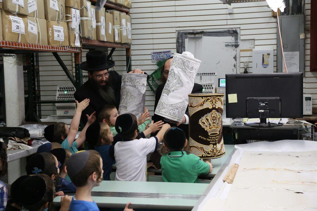 With the sefer Torah mantels. (JDN)