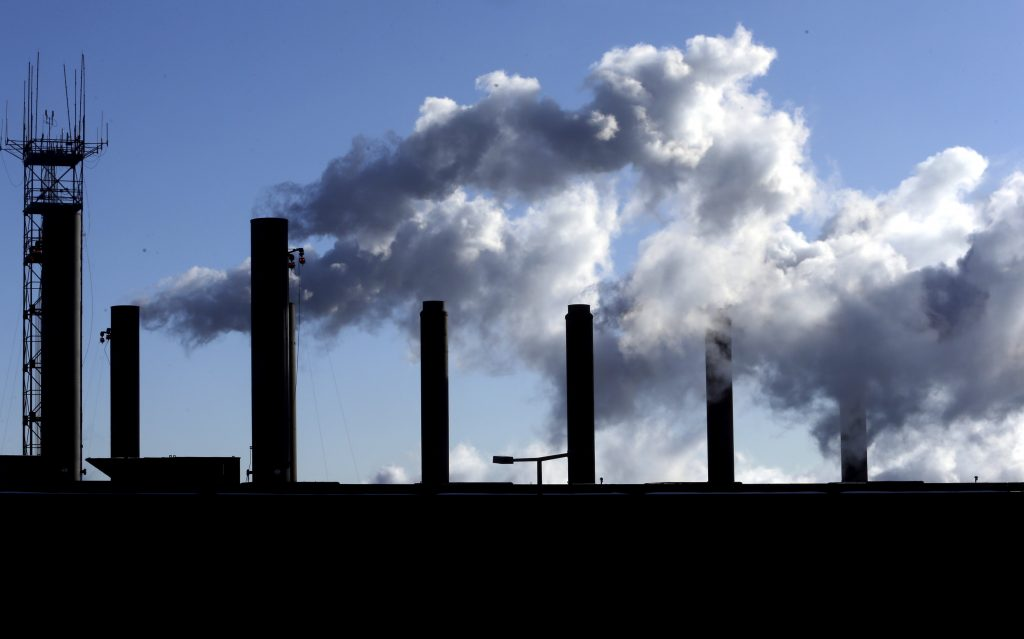 FILE - This Jan. 7, 2015, file photo, shows factory chimneys near O'Hare International Airport in Chicago. On Wednesday, June 15, 2016, the Federal Reserve reports on U.S. industrial production for May. (AP Photo/Nam Y. Huh, File)
