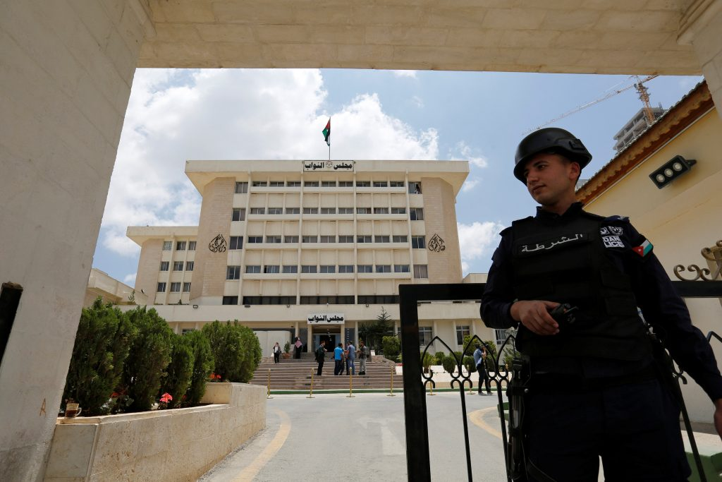 A Jordanian police officer stands guard in front of the parliament in Amman, Jordan May 29, 2016. REUTERS/Muhammad Hamed