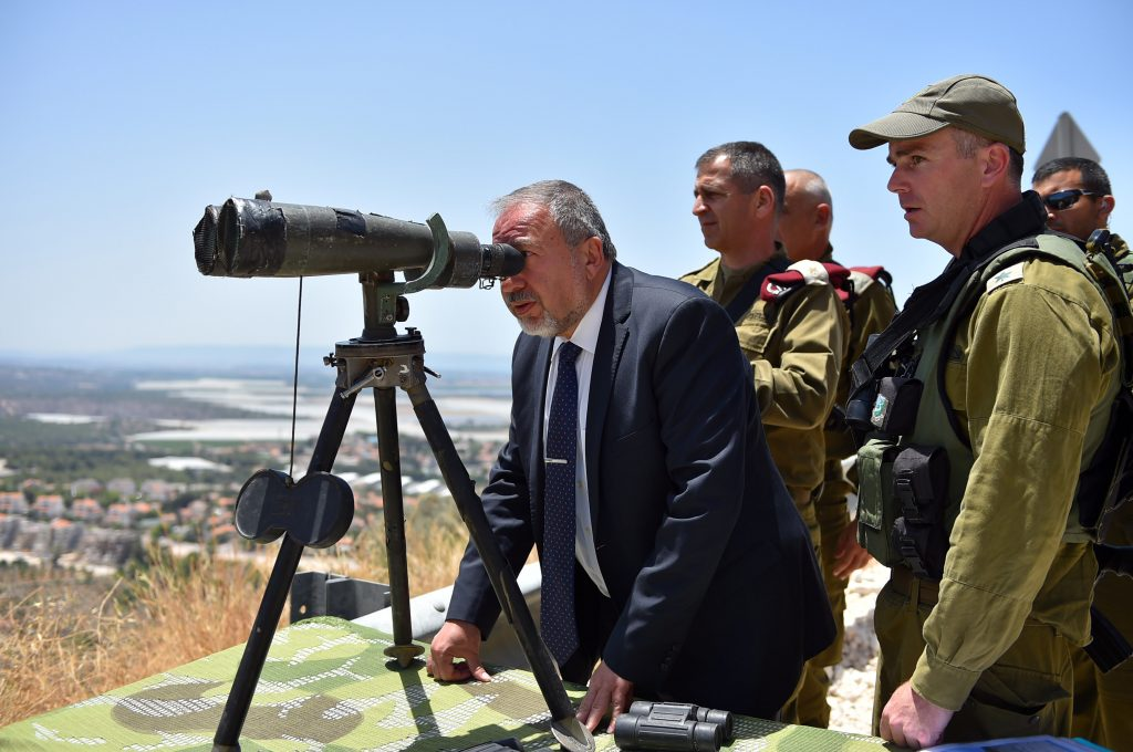 Defense Minister Avigdor Liberman seen gazing through binoculars during a visit to the Northern Command on Tuesday. (Ariel Hermoni/Ministry of Defense)