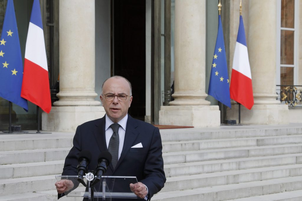 French Interior Minsiter Bernard Cazeneuve speaks to the media after a crisis meeting at the Elysee Palace in Paris, France, June 14, 2016, the day after a French police chief was fatally stabbed in front of his home in a Paris suburb late on Monday and his partner's body was found inside, killings the Islamic State's Amaq news agency said were carried out by the militant group. REUTERS/Philippe Wojazer