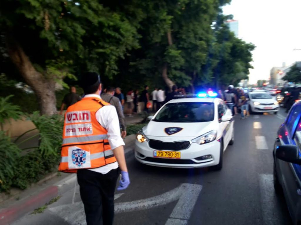 Security and medical personnel at the scene of the attack in Tel Aviv, May 30. (MDA)