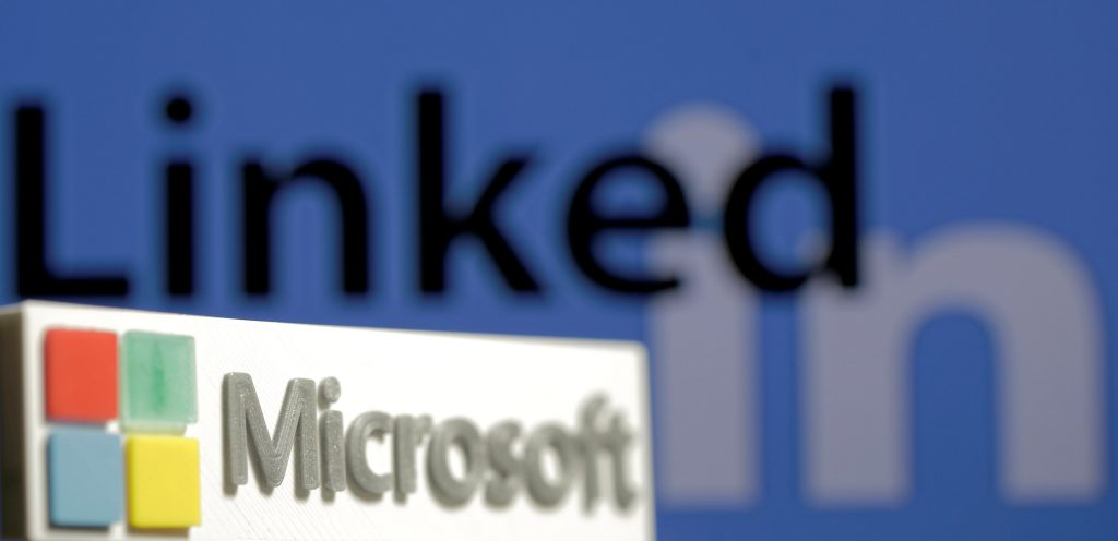 A 3D printed logo of Microsoft is seen in front of a displayed LinkedIn logo in this illustration taken June 13, 2016. REUTERS/Dado Ruvic/Illustration