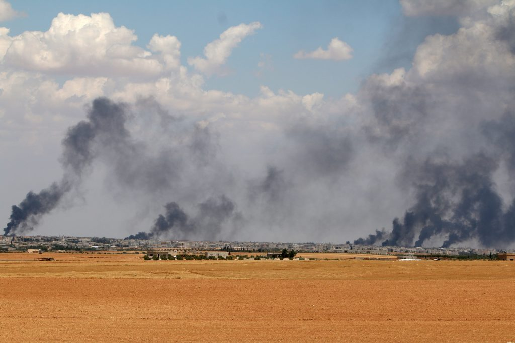 Smoke rises from Manbij city, Aleppo province, Syria June 8, 2016. REUTERS/Rodi Said