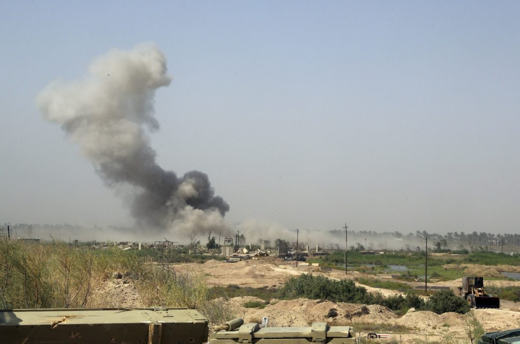 Smoke rises from Islamic State group positions after an airstrike by U.S.-led coalition warplanes as Iraqi counterterrorism forces face off with Islamic State militants in the Nuaimiya neighborhood of Fallujah, Iraq, Wednesday, June 1, 2016. The U.N. children's fund has issued a stark warning to Iraqi troops and Islamic State militants to spare the children amid a battle to retake the city of Fallujah city. UNICEF says it's concerned for the safety of an estimated of 20,000 children trapped inside this city west of Baghdad as very few families have managed to flee Fallujah since the offensive started more than a week ago. (AP Photo/Khalid Mohammed)