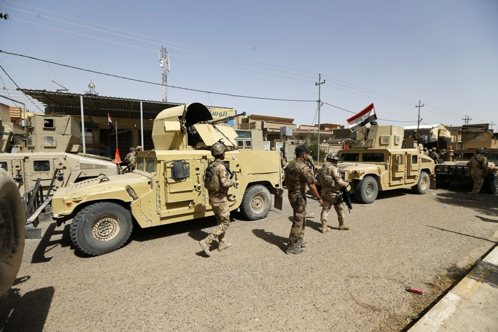 Iraqi security forces entering central Fallujah on Friday. (AP Photo)